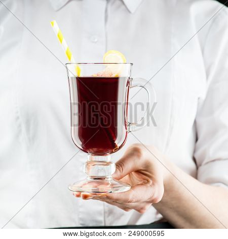The Unidentified Waiter Brings A Hot Non-alcoholic Mulled Wine With Orange And Cinnamon