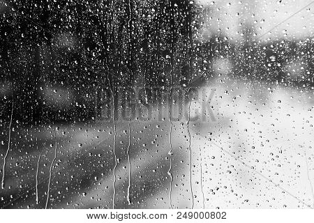 Rainy Traffic. View From Wet Window Of Car