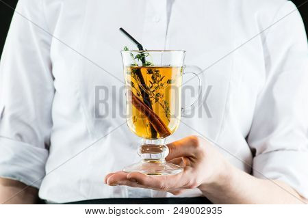 The Unidentified Waiter Brings A Hot Amaro Cocktail With Apple Juice And Cinnamon