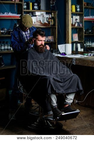 Hipster Hairstyle Concept. Hipster Client Getting Haircut. Barber With Clipper Trimming Hair On Nape