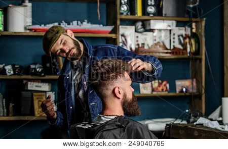 Hipster Client With Fresh Haircut Or Hairstyle. Barber Styling Hair Of Bearded Client With Wax By Ha