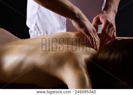 Massage. Spa Massage And Body Treatment. Man Make Massage For Naked Woman. Body Massage In Spa Salon