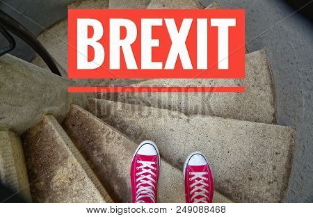 Red Sneakers On Spiral Staircase When Going Downhill With Inscription Brexit Symbolizing The Withdra