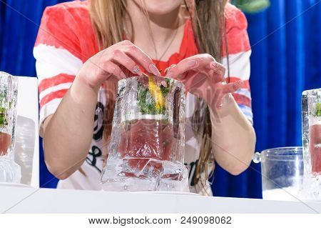 Unidentified Barman Preparing Cocktail In The Glass Made From Ice