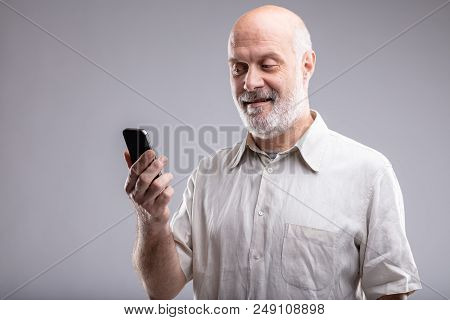 Senior Man Very Happy With His Smartphone