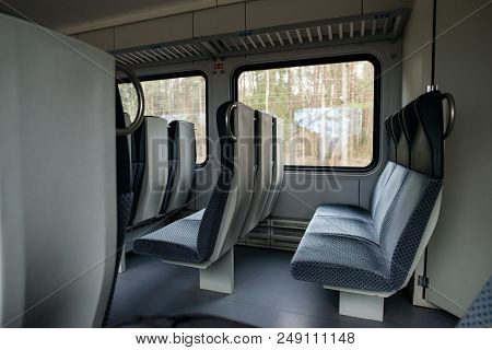 Empty Interior View Of Modern Train In Europe, Rows Of Unoccupied Seats. Public Transport