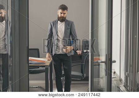 Confident Man In Casual Suit At Working Place. Bearded Man Look Out Room Door. Businessman In Modern