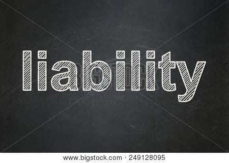 Insurance Concept: Text Liability On Black Chalkboard Background