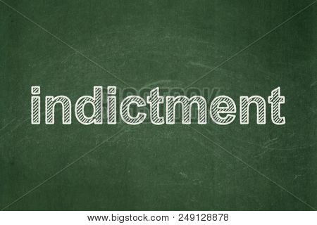 Law Concept: Text Indictment On Green Chalkboard Background