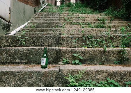 Soju Bottle On The Steps
