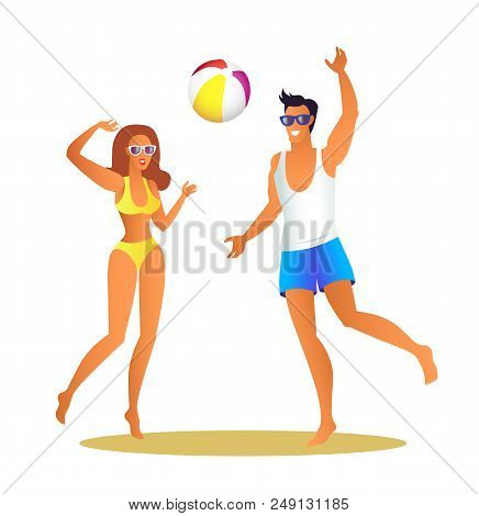 Man And Woman In Swimwear Play Volleyball On Beach. Girl And Guy Throw Inflatable Ball. Young Couple