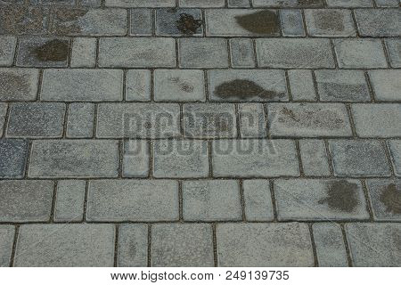 Gray Stone Texture Of Dirty And Wet Paving Slabs