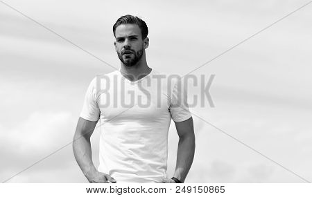 Macho Wearing White Tshirt. Male Body With Sexy Torso. Man With Unshaved And Concerned Face On Clear
