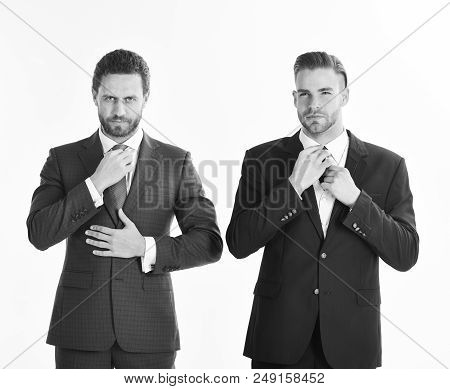 Businessmen With Serious Faces Wears Classic Suits, Isolated On White Background. Business Partners