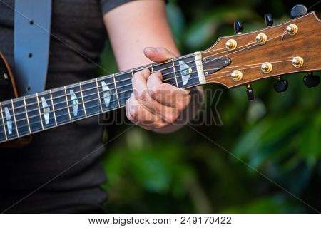 Guitar Player With The Guitar In Hand
