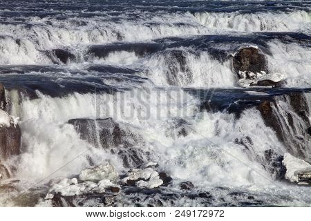 A Close Up Of The Raging Waters At The Gullfoss Waterfall In Iceland