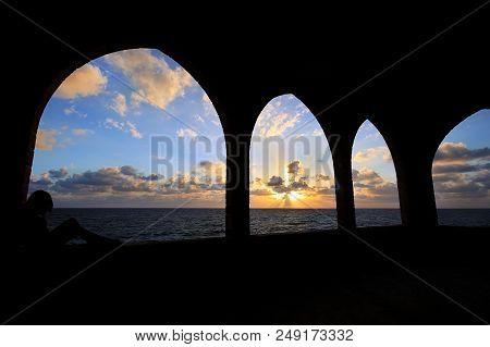 Silhouette Of A Girl Contemplating A View Of The Mediterranean Sea Through Arches In Batroun, Lebano