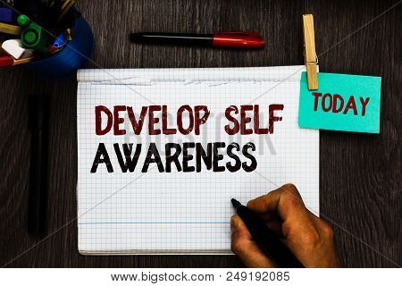 Conceptual hand writing showing Develop Self Awareness. Business photo text increase conscious knowledge of own character Register pages handwriting text work stationery items woody table poster