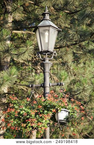 Close View Of Wieliczka Old Town Lamppost With Flowers In A Sunset Light (poland).