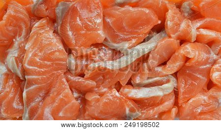 Homemade delicacy - appetizing slices of salted salmon for sandwiches close-up poster