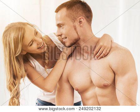 Guy With Naked Torso With His Smiling Cute Wife. Happy Family Relationships. Family Idyll. Establish