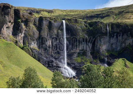 Waterfall Along The South Coast Of Iceland On A Summer Day