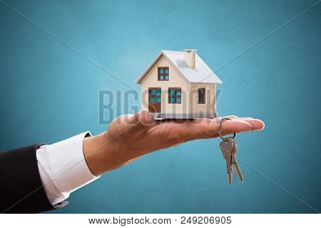 Businessperson With House And Key