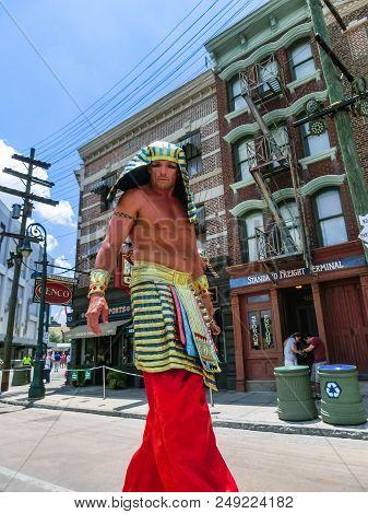 Orlando, Florida, Usa - May 08, 2018: The Man On Stilts Near Entrance To Revenge Of The Mummy Ride.
