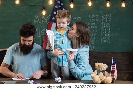 Dream Concept. Little Boy And Parents Dream About Travelling And Launch Paper Planes In Class. Ameri
