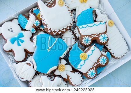 Candy bar on baby's christening party: various gingerbreads with blue mastic poster