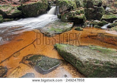 Flowing Water Through Boulders On A Forest Brook