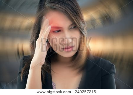 Working Woman Has Headache Against Gray Background, Benign Paroxysmal Positional Vertigo: Bppv, Conc