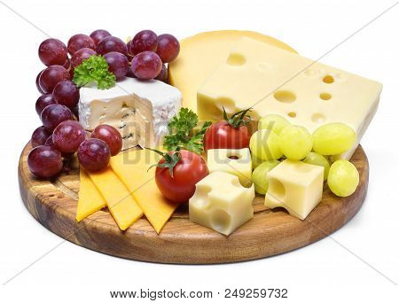 Delicious cheese plate with various sorts of cheese like Emmentaler, gouda and brie. Gourmet cheese