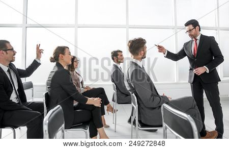 Picture showing business people having a conference