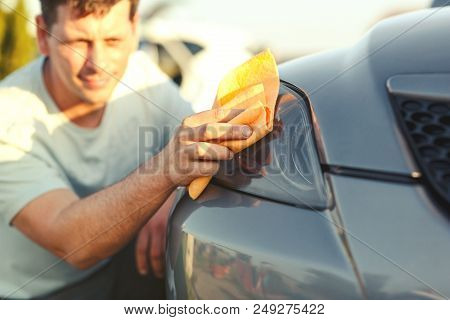 Close Up Of Man Cleaning Car With Microfiber Cloth, Car Detailing