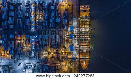 Aerial Top View Container Cargo Ship Working At Night, Business Logistic And Transportation Of Inter