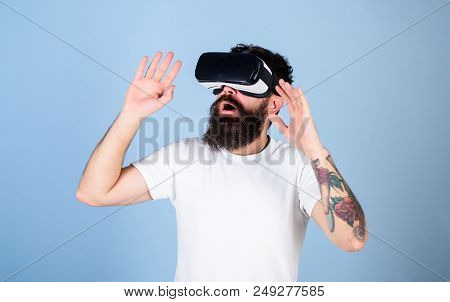 Man With Beard In Vr Glasses, Light Blue Background. Vr Gadget Concept. Hipster On Busy Face Explori