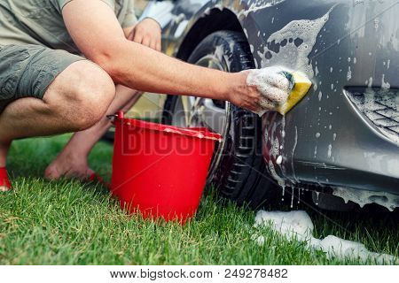 Sponge And Bucket -young Male Washing His Car