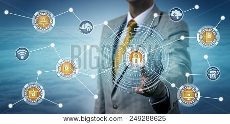 Unrecognizable Cybersecurity Specialist Consolidating Device Management Via Touch Screen. Informatio