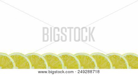 Sliced Yellow Lemons On A White Background. Halved Lemon Fruits On A Empty Background.