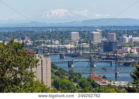 Portland Oregon Downtown With Bridges Over Willamette River And Mount Saint Helens View