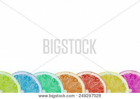 Close-up Of Sliced Multi Colored Fruits On A White Background. View To To Fresh Colorful Citrus Frui