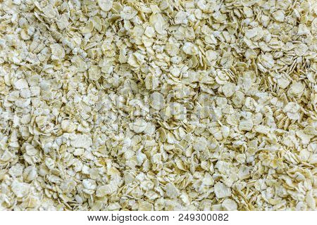 Close-up Of Fresh And Healty Oat Flakes. View From Above To Natural Oat Flakes. Natural Raw Food And