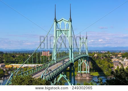 St Johns Bridge Over Willamette River And Cathedral Park In Portland Oregon On A Blue Sky Sunny Day
