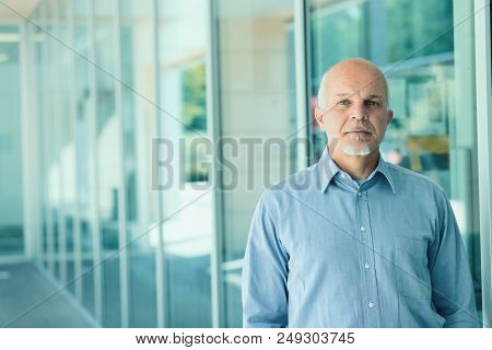 Mature Man Standing In A Business Place
