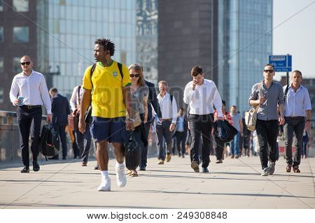 London, Uk - 20 April, 2018: City Of London With Lots Of Commuters Crossing The London Bridge On The