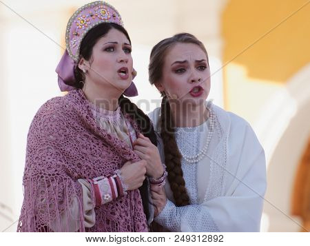 ST. PETERSBURG, RUSSIA - JULY 12, 2018: Olga Cheremnykh as Marfa (right) and Anastasia Samarina as Dunyasha in the opera The Thar's Bride outdoors during the festival All Together Opera