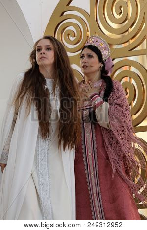 ST. PETERSBURG, RUSSIA - JULY 12, 2018: Olga Cheremnykh as Marfa (left) and Anastasia Samarina as Dunyasha in the opera The Tsar's Bride outdoors during the festival All Together Opera