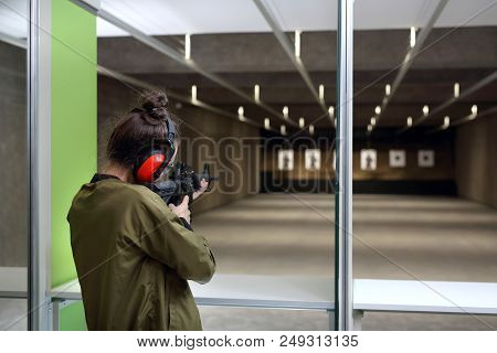 Learning To Shoot. A Woman At The Shooting Range.