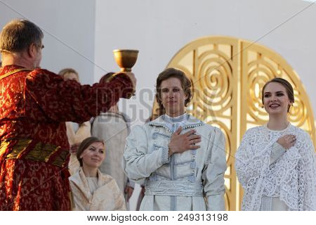 ST. PETERSBURG, RUSSIA - JULY 12, 2018: Olga Cheremnykh as Marfa (right) and Ilya Selivanov as Lykov (center) in the opera The Thar's Bride outdoors during the festival All Together Opera